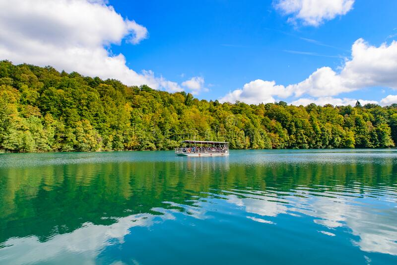 Boat ride on turquoise lake at Plitvice Lakes National Park, Croatia royalty free stock photo