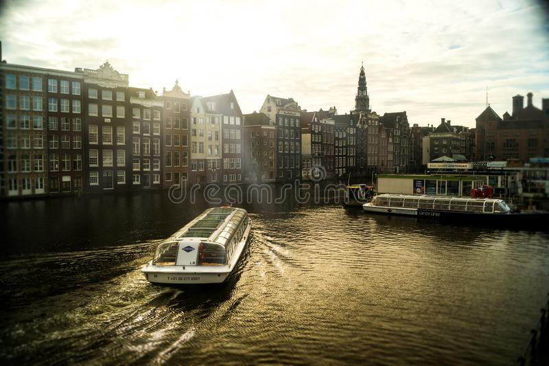 Boat on a River in Amsterdam stock photos