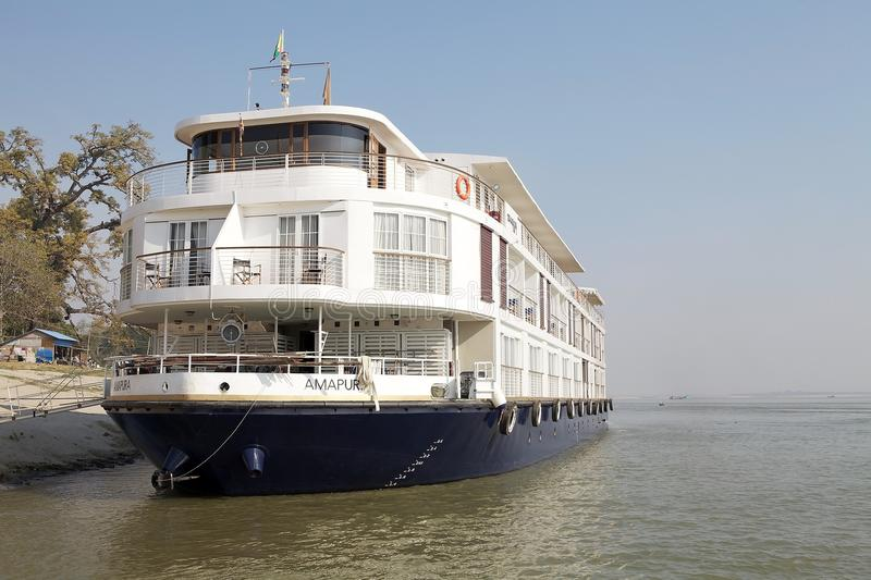 Boat for river cruises on the Irrawaddy river Myanmar. Burmese boat for river cruises on the Irrawaddy river at Mingun, Myanmar. The Irrawaddy river flows from royalty free stock photo