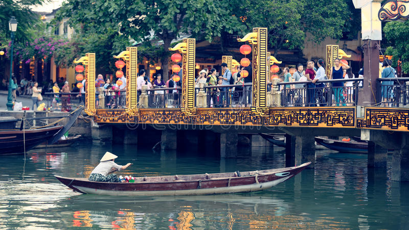 Boat in river in Hoi An. A traditional wooden boat in the river in Hoi An, Vietnam royalty free stock image