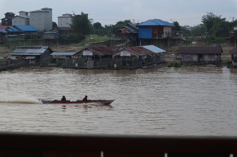 Boat in river Kahayan Palangka Raya city. Walking by boat is great for seeing the scenery along the river stock photography