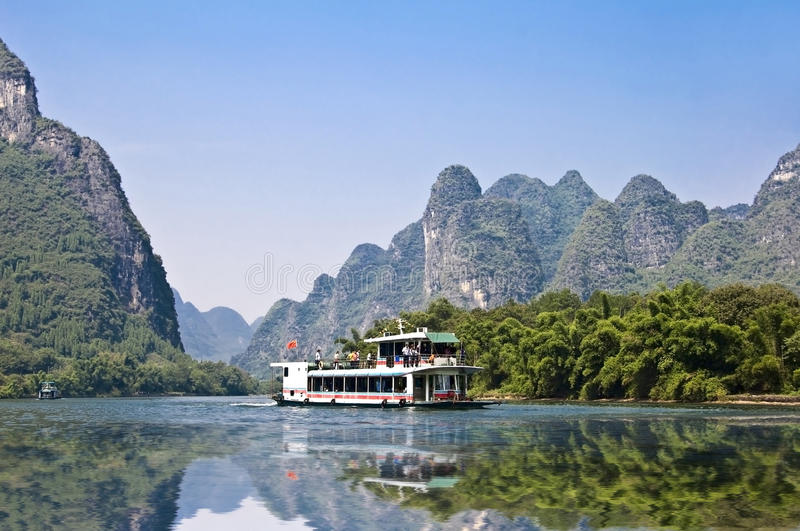 Boat on the river Li (lijang) between Guilin and Yangshuo, Guangxi royalty free stock photography