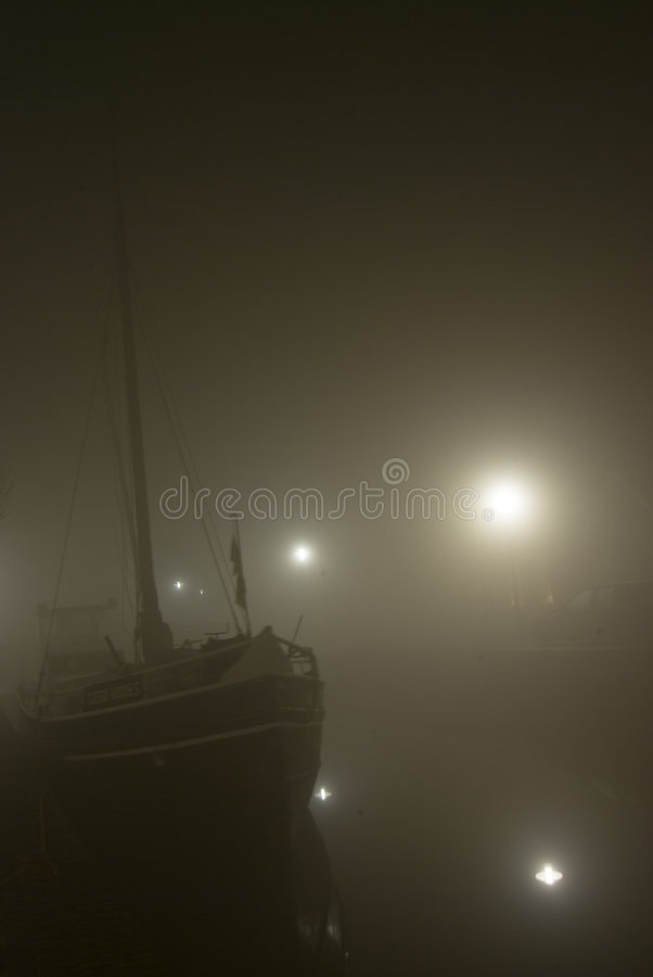 Boat on river at night stock photos