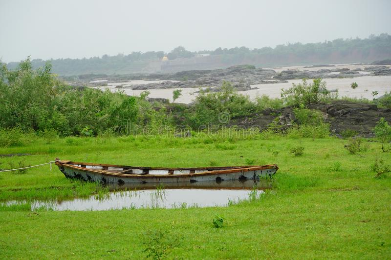Boat on the river side in monsoon. Boat on the river side in the monsoon, boat near dam royalty free stock photography