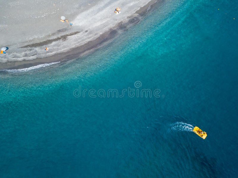 Boat sailing from above and coastline stretch of coast, beach and vacations, relaxation. Aerial view stock image