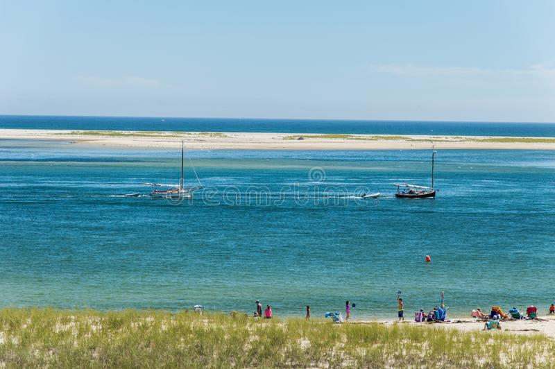 Chatham Lighthouse Beach, MA, USA. Boat sailing along the The Chatham Lighthouse Channel, in Cape Cod Massachusetts, USA royalty free stock images