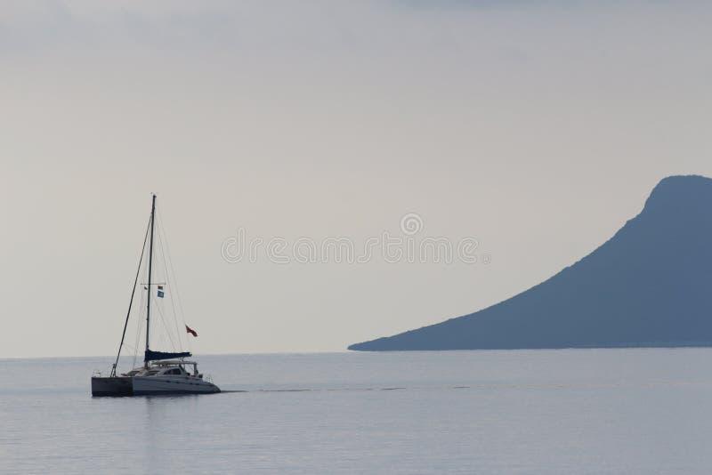 A boat sailing along the coast of Lefkada, Ionian Sea,  Greece. royalty free stock photo