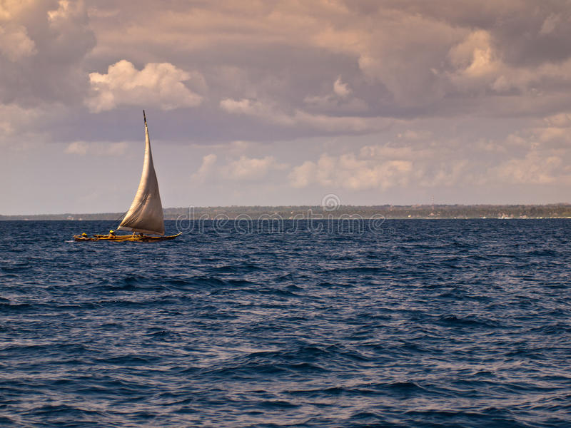 Download Boat Sailing In The Blue Sea Royalty Free Stock Photography - Image: 34122957
