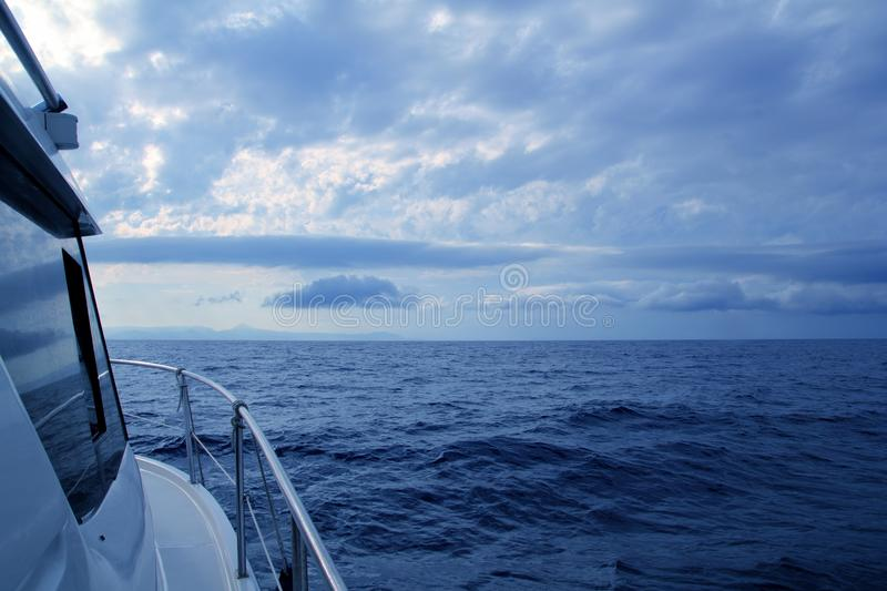 Download Boat Sailing In Cloudy Stormy Day Blue Ocean Stock Photo - Image: 16932156