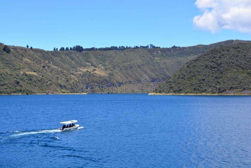 Boat sailing on the Cuicocha lake, in Otavalo, Ecuador stock photo