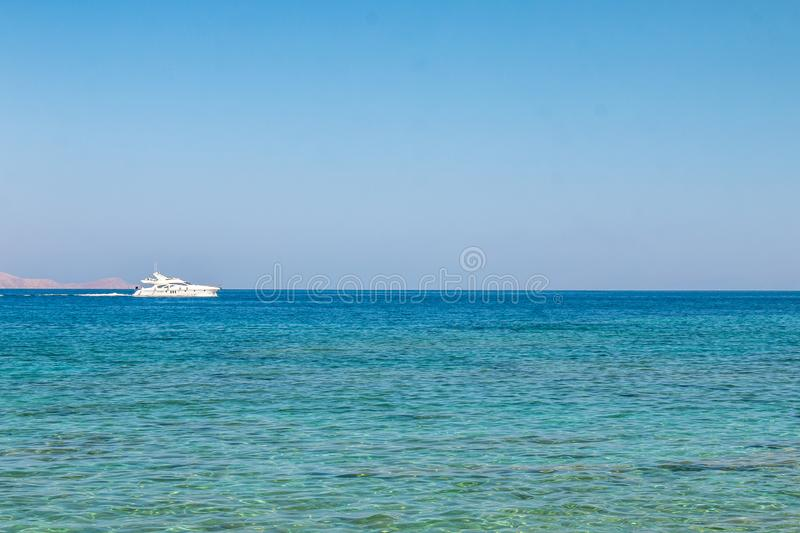 Boat sailing far at the open sea. Yacht at sea. Luxury summer adventure, active vacation in Mediterranean. Sea stock photo