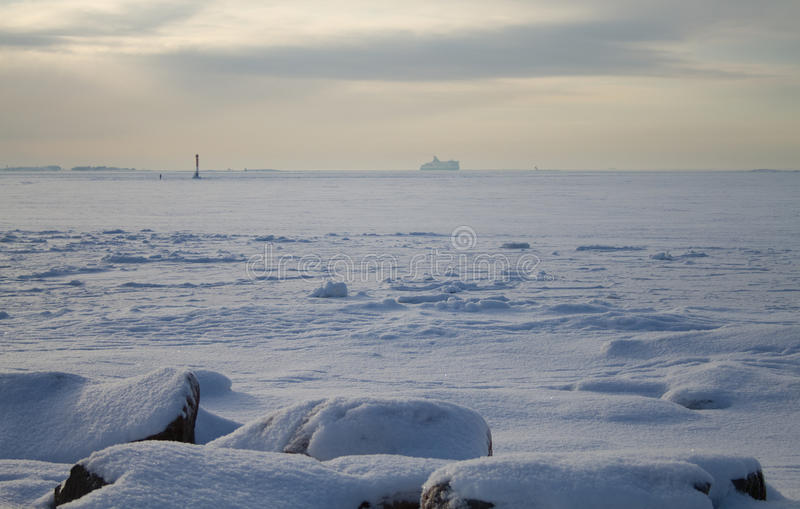 Boat sailing on frozen sea stock images