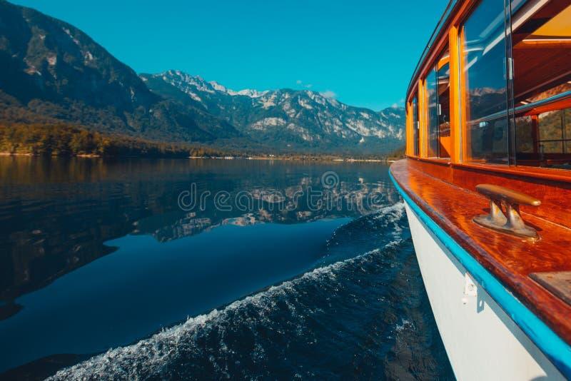 Boat sailing on lake Bohinj royalty free stock photography