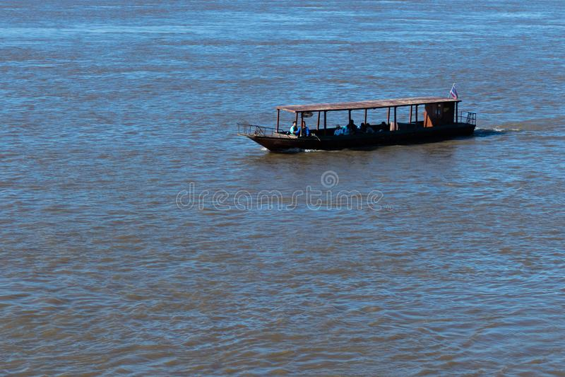 Boat sailing on the river with backdrop of shining sun royalty free stock images