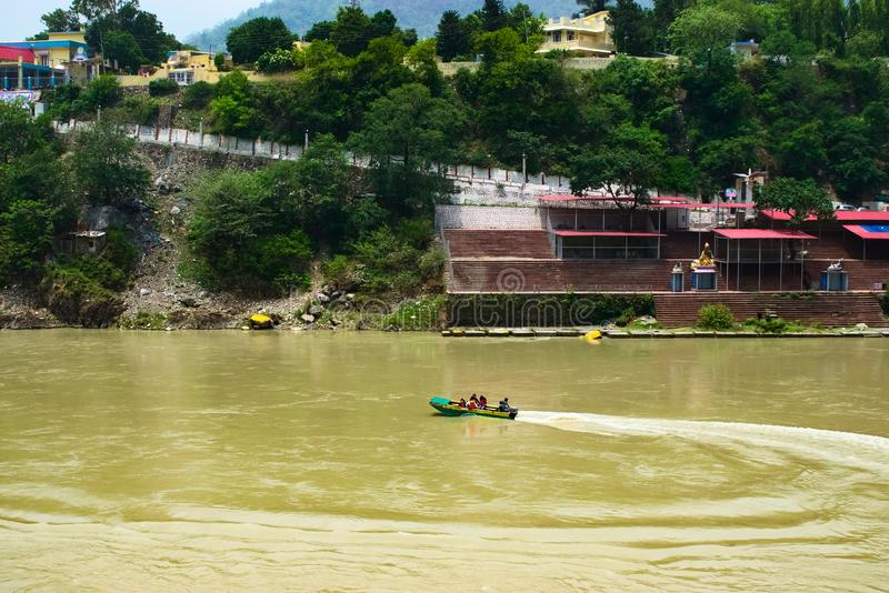 Boat sailing in the River in the holy city of Rishikesh in India very popular tourist destination and Beautiful natural surroundin stock photos