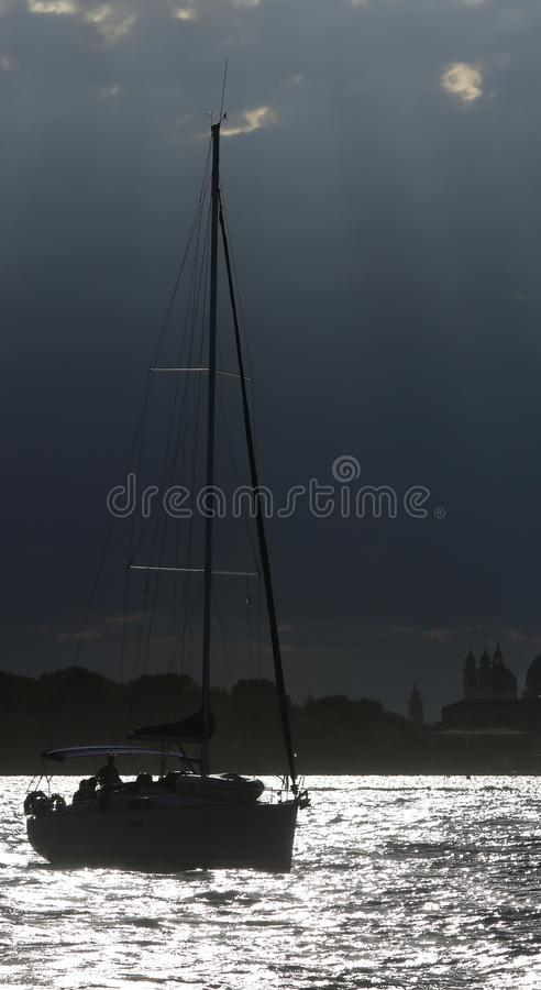 Boat sailing on the sea with backlit effect. Boat sailing on the sea with backlit photographic effect stock photography