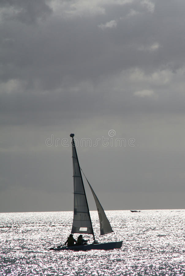 Download Boat Sailing In The Sunset Stock Photo - Image: 39445016