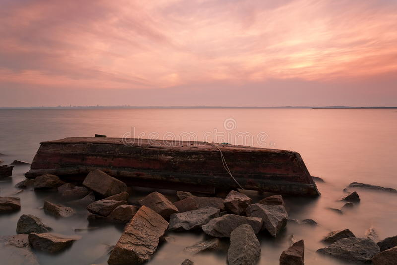The boat sank. Qingdao coast beautiful scenery,beautiful sunset wreck landscape stock images