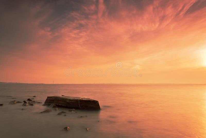 The boat sank. Qingdao coast beautiful scenery,beautiful sunset wreck landscape royalty free stock photo