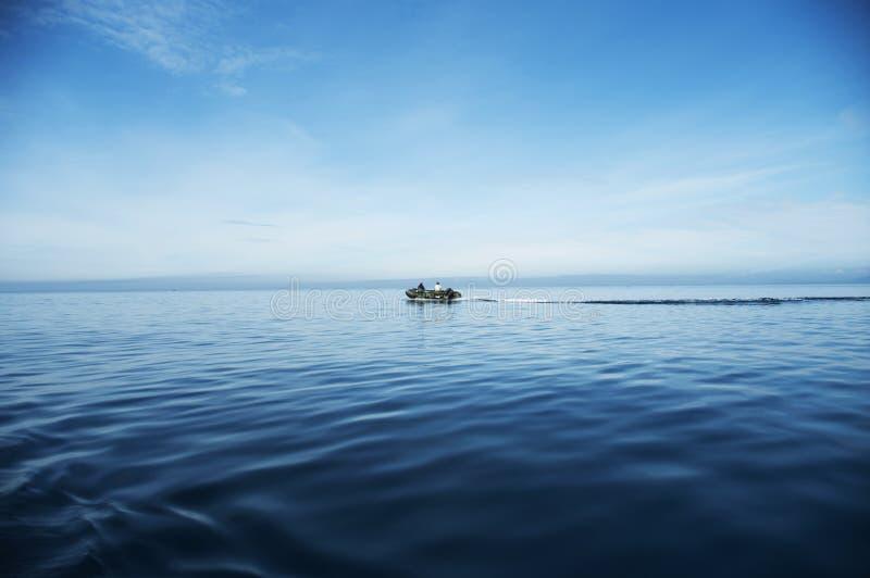 Download Boat at-sea stock image. Image of cloud, dark, fish, size - 14914209
