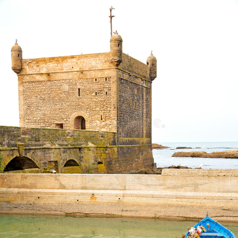 Boat and sea in africa morocco old castle brown brick sky. Boat and sea i n africa morocco old castle brown brick sky royalty free stock photo