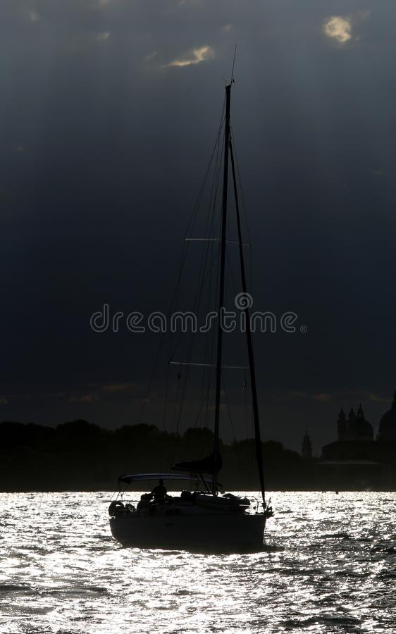 Boat on the sea with backlit effect. Boat on the sea with backlit photographic effect stock photo