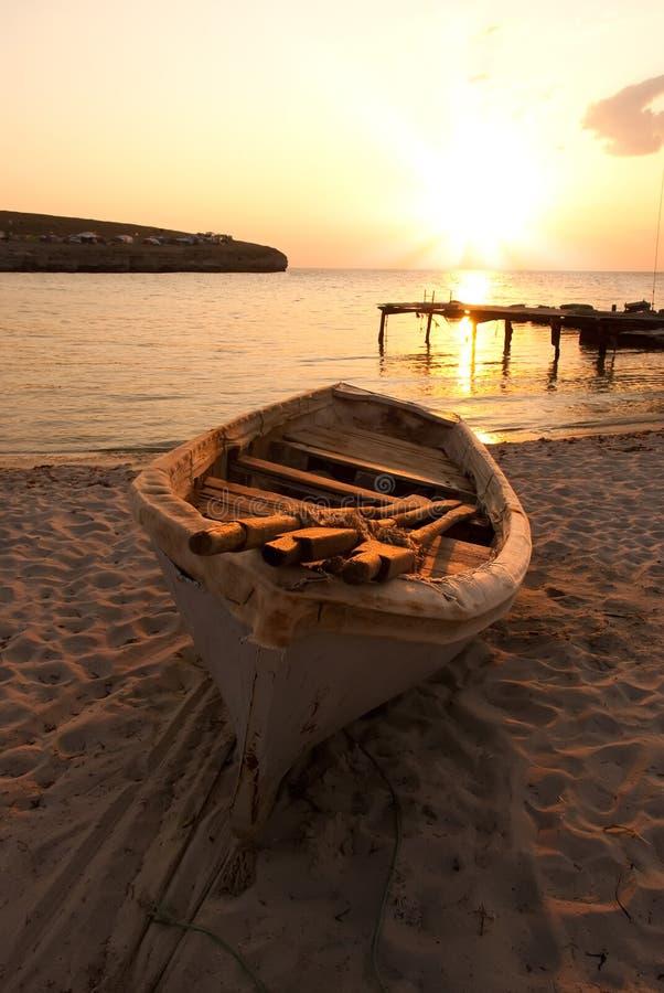 The boat on the sea coast stock photography