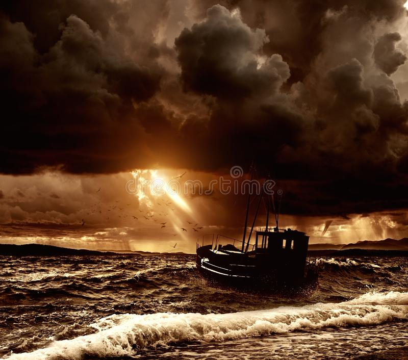 Boat in sea. Fishing boat in a stormy sea stock photos
