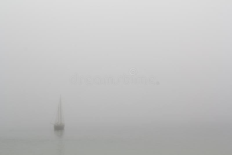 Boat in the sea with fog royalty free stock photography