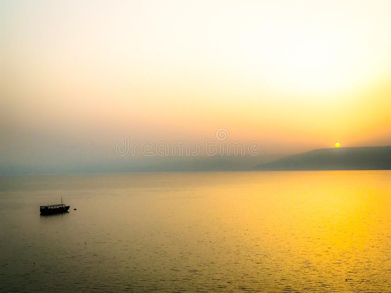 Fishing Boat on Sea of Galilee at Sunrise. Boat on the Sea of Galilee in Holy Land stock images