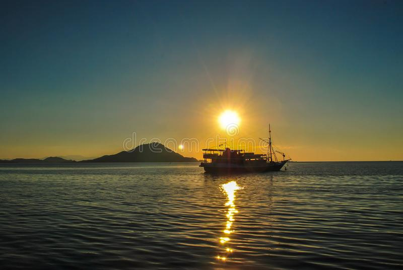Boat on the sea at sunset in tropical Komodo island, Labuan Bajo, Fores, Indonesia royalty free stock photos