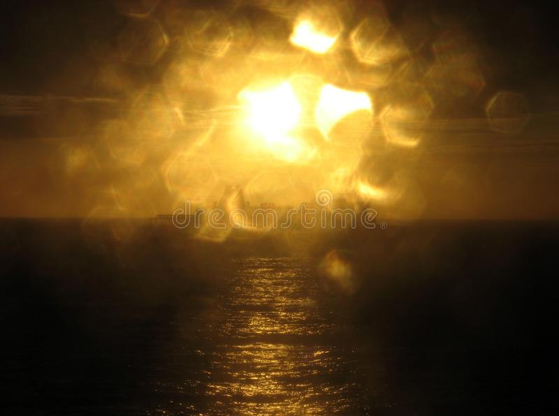 Boat, Sea and Sunset. A view on a boat, sea and sunset throug a wet glass of a ferry, traveling to England royalty free stock image