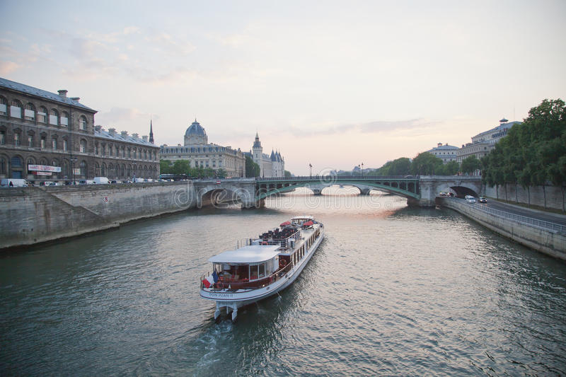 A boat on the Seine River in Paris stock photo