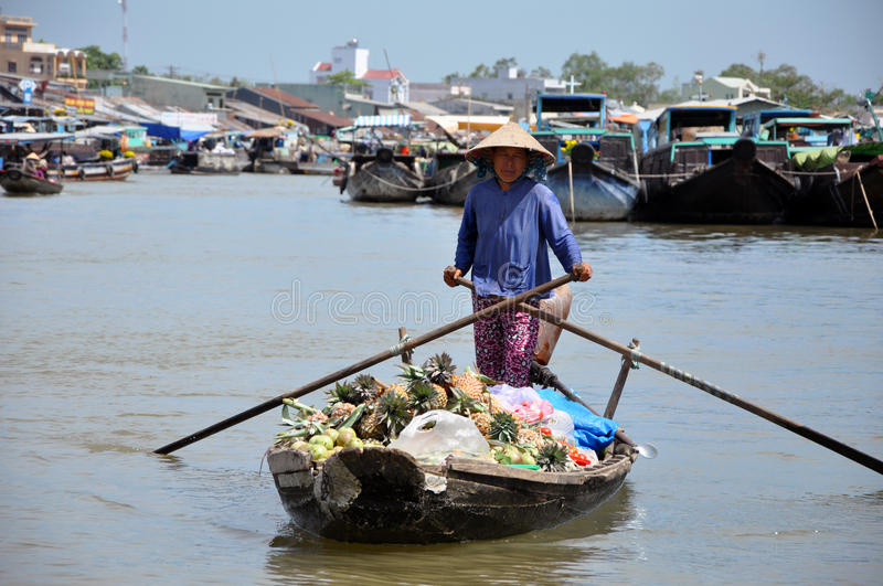 Boat seller at Mekong floating market. CAN THO - FEB 17: Unidentified seller at the Floating Market. With hundreds of boats, Cai Rang is one of the biggest stock photos