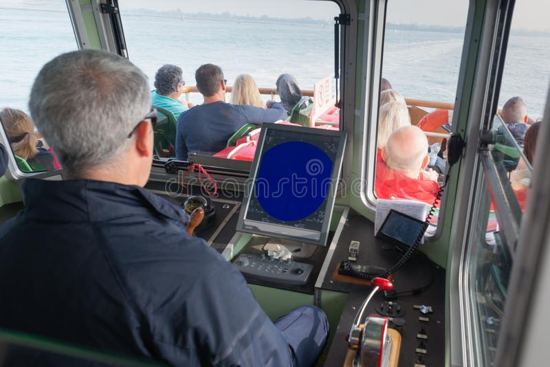 Boat ship captain in Venice vaporetto public transport pilot royalty free stock photography
