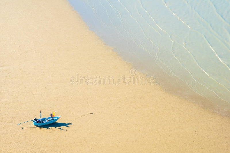 Boat on the shore awaits a tide royalty free stock photography