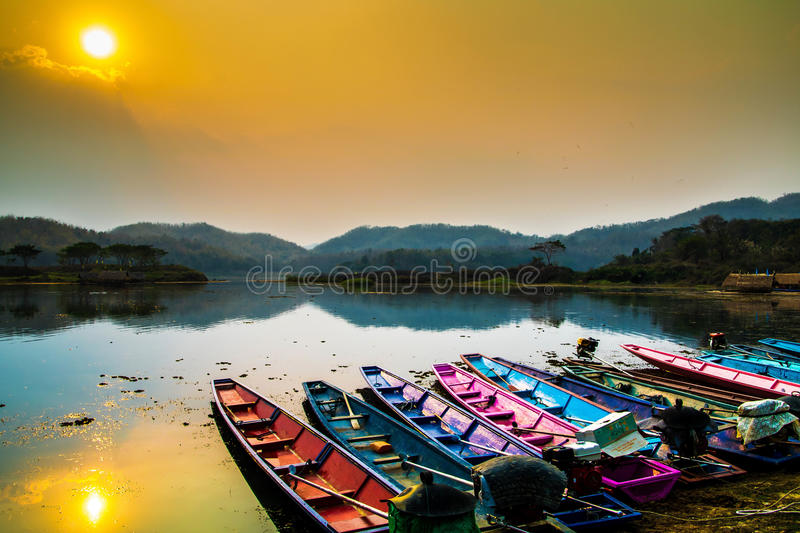 Boat on the shore of a misty lake royalty free stock photos