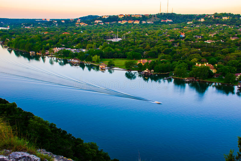 Boat showing Motion Austin Texas Colorado river bend. Boat showing Motion in Austin Texas on the Colorado river bend. the water is perfectly still as the fast stock photo
