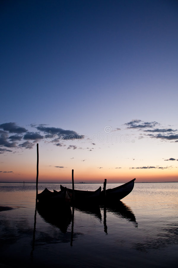 Boat Sillhouettes at Sunset stock photography