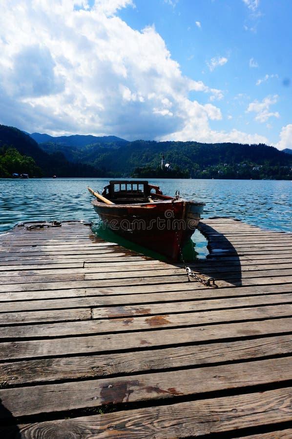 Boat sits at dock stock photos