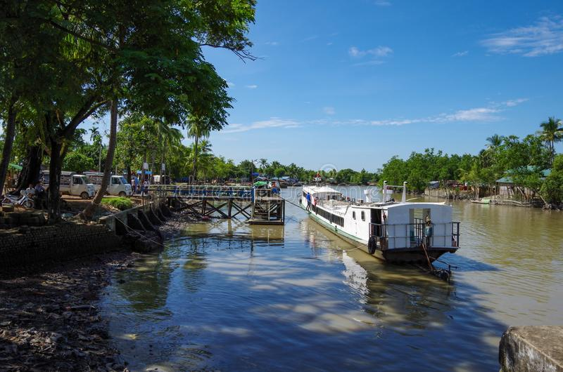 A boat in the small and dirty harbor of Mrauk-U royalty free stock photos