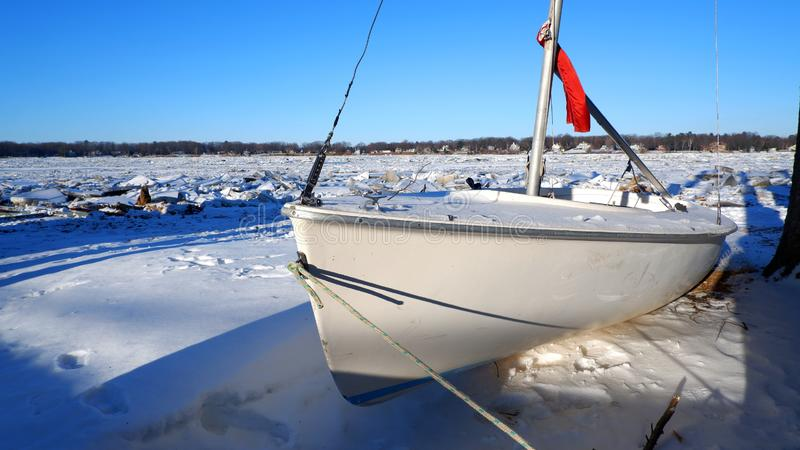 Boat in a snow and ice decor stock photo