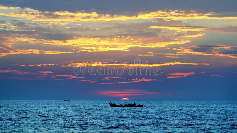A boat starting for a new day royalty free stock photos