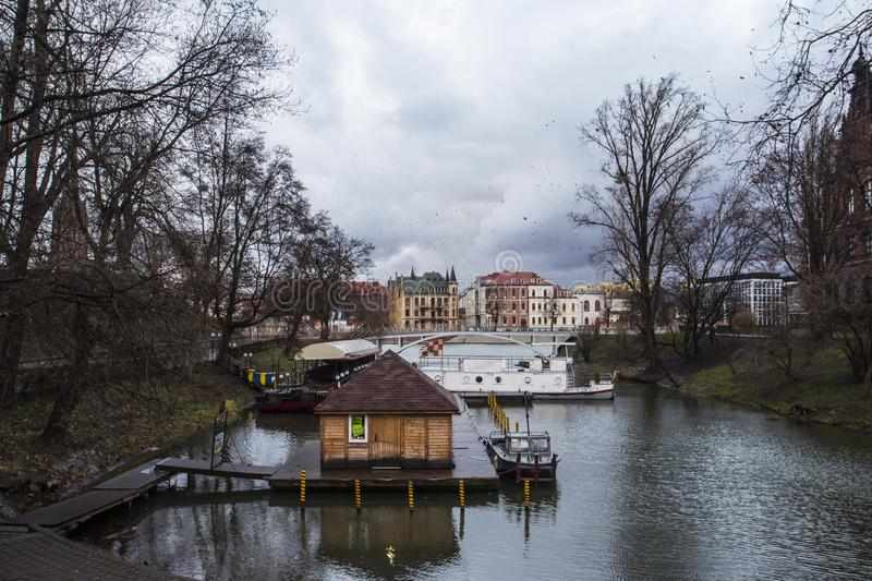 Boat station on the river Oder in cloudy weather in the city of Wroclaw. Poland.  royalty free stock photo