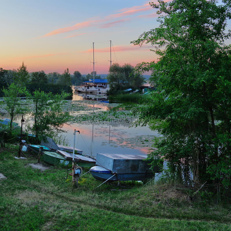 Boat station. Summer sunrise on the boat station. Dnepropetrovsk. Ukraine stock images