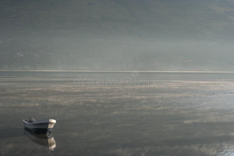 Boat on still water stock image