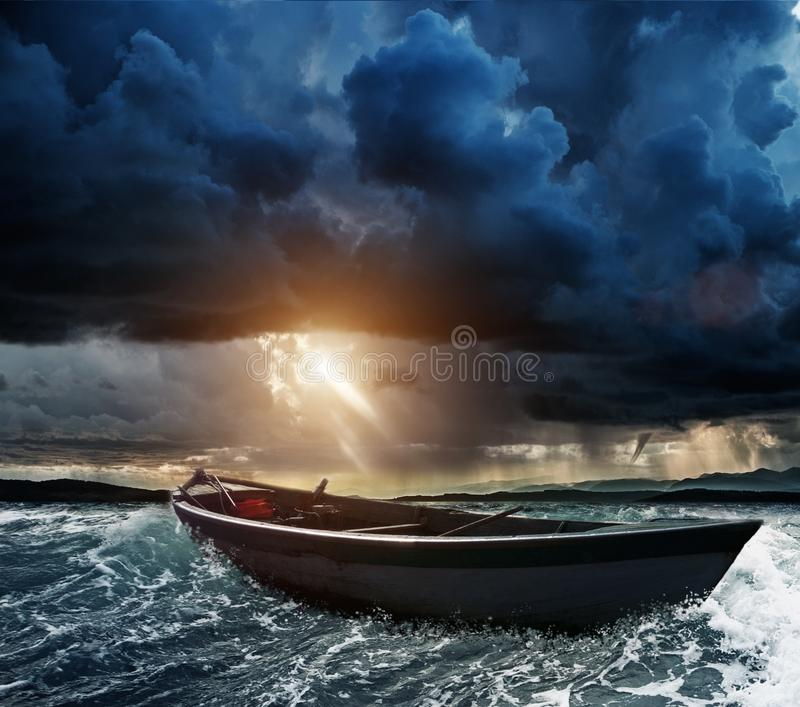 Boat in stormy sea royalty free stock images