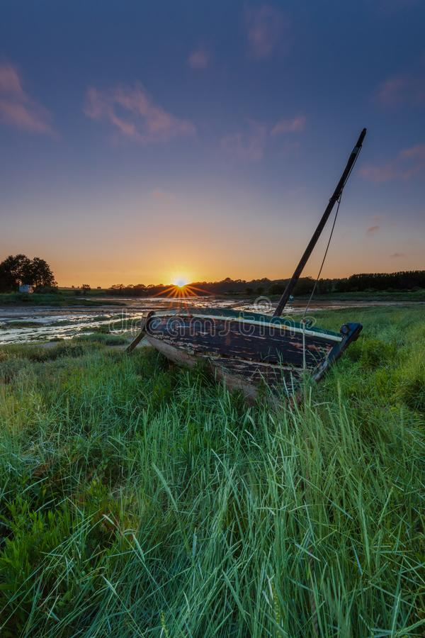 Boat stranded in the grass royalty free stock photo
