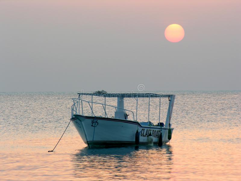 Boat at sunrise royalty free stock images