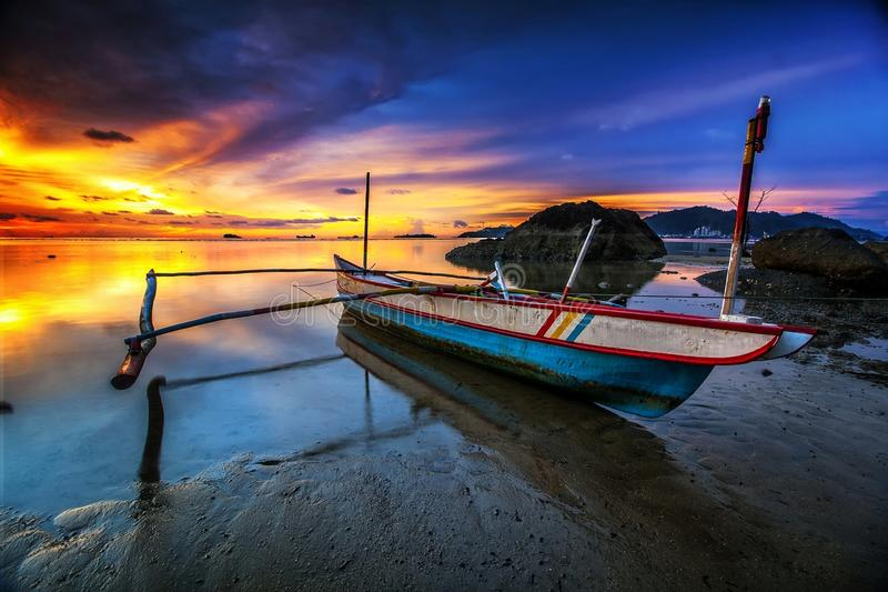 The boat. Sunset and boat stock photo